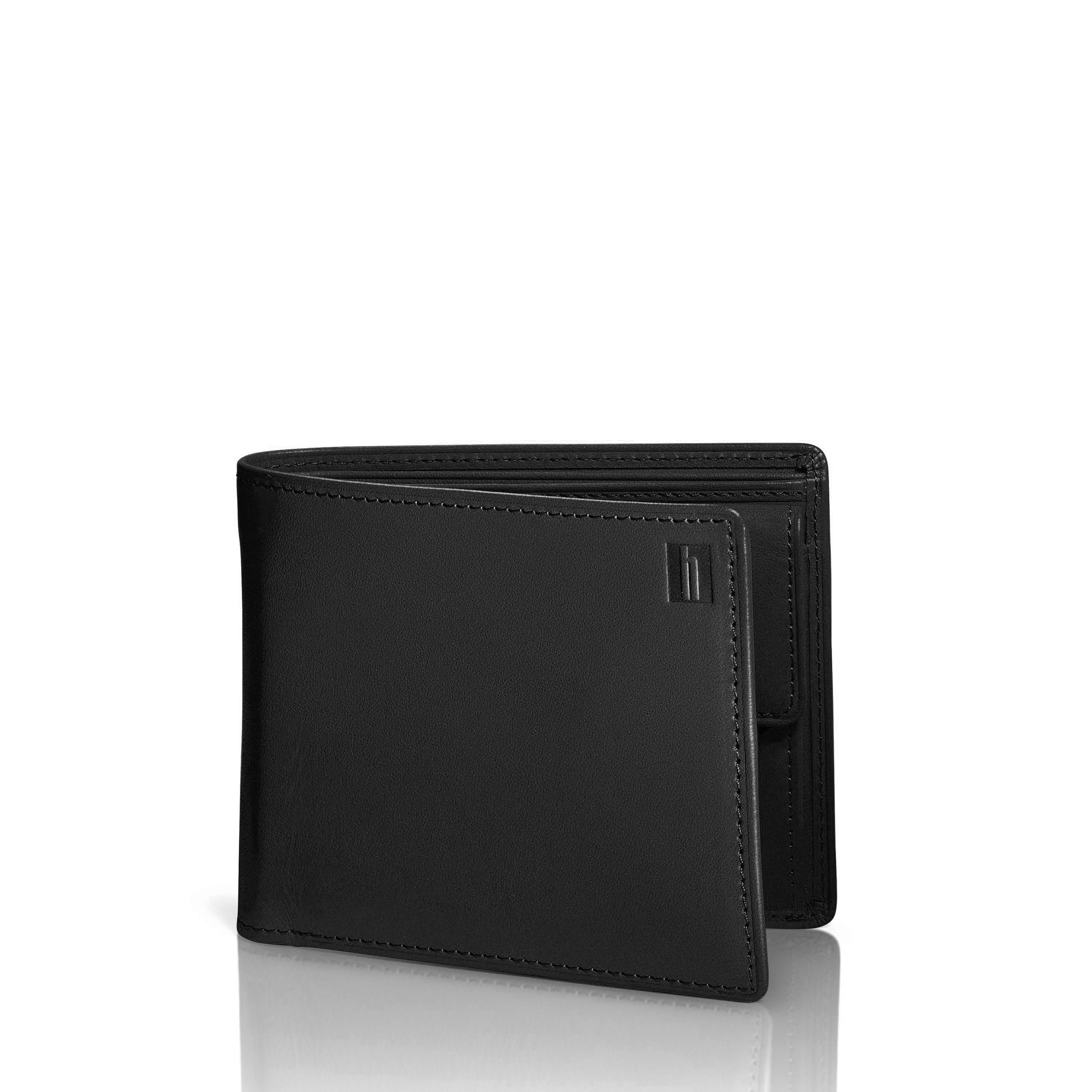 "Vegetable tanned leather. Heat burnished details. Finely finished stitching. Durable nylon lining. 4 card slots. Two bill compartments. Stows cash, cards and receipts in a slim compact design. Currency pocket. Weight: 0.36 lbs. Body Dimensions: 4.5"" x 3.75"" x 1.0"""